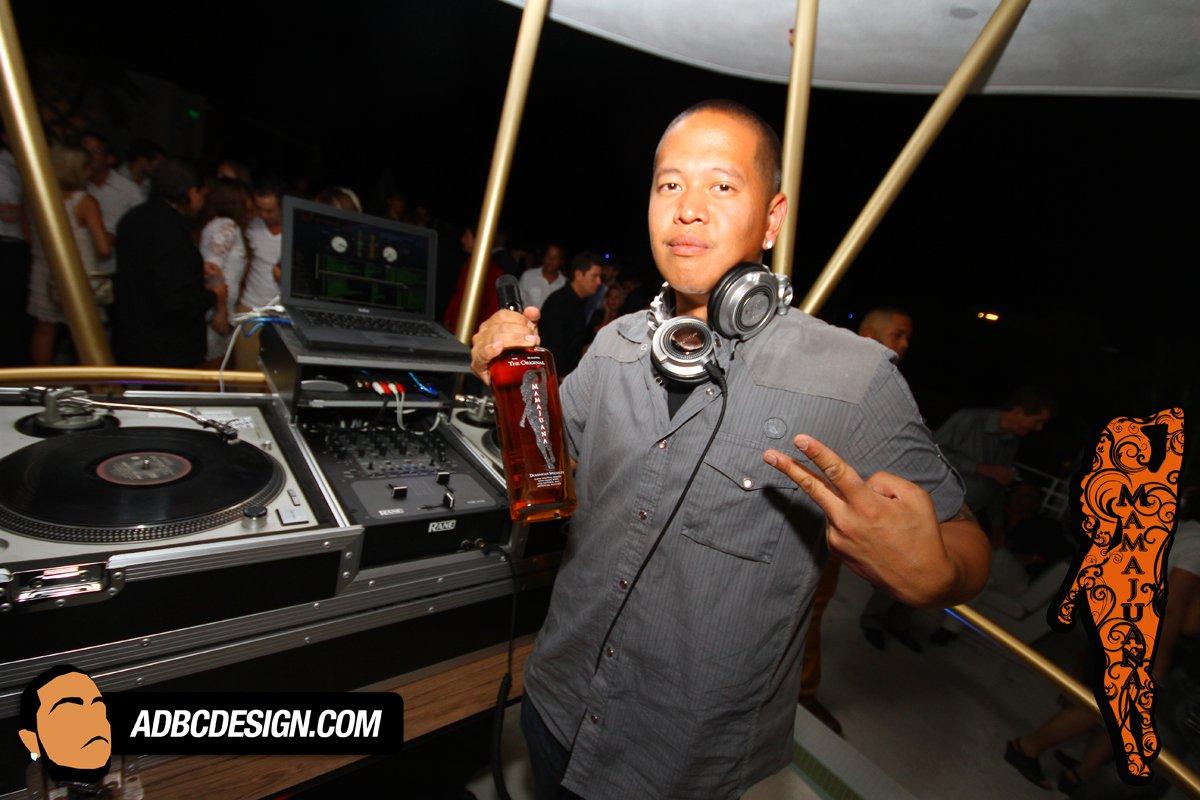 DJ Yoshi w/ The Original MamaJuana Bottle